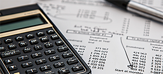 calculator and pen for accounting