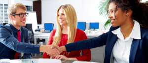 andidate shaking hands with recruiter at a temp agency