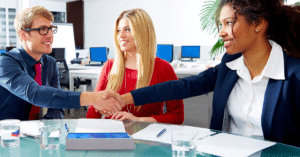 recruiter shaking hands with candidate at temp agency